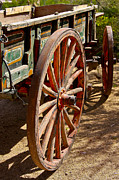 Wagon Wheels Photos - Pioneer Village Wagon Wheels by John Haldane