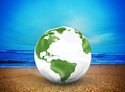 Think Art - Planet earth model on the beach by Michal Bednarek