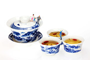 Asian Ceramics Posters - Playing among blue-and-white porcelain little people on food Poster by Paul Ge