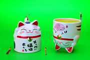 Laughing Digital Art Prints - Playing golf on cat cups Print by Mingqi Ge