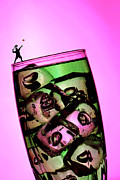 Wine Glasses Prints - Playing tennis on a cup of lemonade little people on food Print by Paul Ge