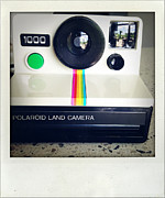 Aged Photo Framed Prints - Polaroid camera.  Framed Print by Les Cunliffe