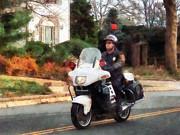 Police - Motorcycle Cop On Patrol Print by Susan Savad