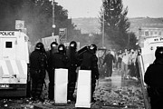 Unrest Framed Prints - Police officers in riot gear face rioters on crumlin road at ardoyne Framed Print by Joe Fox