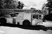 Polish City Prints - Polish Fire Brigade Fire Guard Straz Krakow Ladder Vehicle Speeding Past On Way To Fire Print by Joe Fox