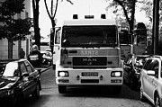 Polish City Prints - Polish Fire Brigade Fire Guard Straz Krakow Vehicle Parked In Middle Of City Street Firefighter Attending Emergency Call Out Print by Joe Fox