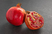 Cut In Half Photos - Pomegranate on a slate plate by Palatia Photo