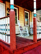 Rocking Chairs Framed Prints - Porch With Red White and Blue Railing Framed Print by Susan Savad