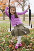 Full Skirt Photos - Portrait Of Young Girl On Swing by Vast Photography