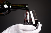 Pouring Wine Photos - Pouring glass of wine by Joe Belanger