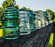 Collects Photo Framed Prints - Pretty Glass Insulators All in a Row Framed Print by Deborah Smolinske