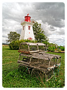 Lobster Traps Photos - Prince Edward Island Lighthouse with Lobster Traps by Edward Fielding