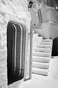 Dug Out Framed Prints - prop doorway and steps at the Sidi Driss Hotel underground at Matmata Tunisia scene of Star Wars films vertical Framed Print by Joe Fox