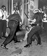 Law Enforcement Prints - Protester Clubbed In Harlem Print by Underwood Archives