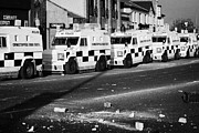 County Police Posters - PSNI armoured land rovers and debris on crumlin road at ardoyne shops belfast 12th July Poster by Joe Fox