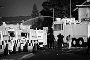 County Police Posters - PSNI armoured land rovers and water canon on crumlin road at ardoyne shops belfast 12th July Poster by Joe Fox