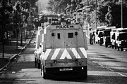 Unrest Framed Prints - PSNI land rovers head up the crumlin road towards loyalists at ardoyne shops belfast 12th July Framed Print by Joe Fox