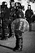 Unrest Framed Prints - PSNI officer in full riot gear with shield on crumlin road at ardoyne shops belfast 12th July Framed Print by Joe Fox