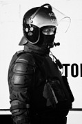 County Police Posters - PSNI officer in ninja riot geat on crumlin road at ardoyne shops belfast 12th July Poster by Joe Fox