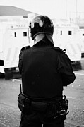 Unrest Framed Prints - PSNI officer in riot gear on crumlin road at ardoyne shops belfast 12th July Framed Print by Joe Fox