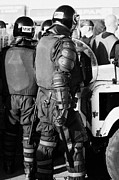 County Police Posters - PSNI officer in riot gear with shield and baton on crumlin road at ardoyne shops belfast 12th July Poster by Joe Fox