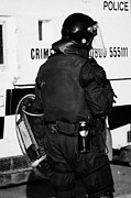 County Police Posters - PSNI officer with riot gear on crumlin road at ardoyne shops belfast 12th July Poster by Joe Fox