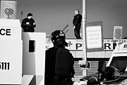 Violent Prints - PSNI officers in protective riot gear at landrovers and snipers on crumlin road at ardoyne shops bel Print by Joe Fox