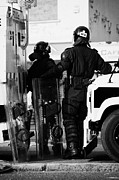Violent Prints - PSNI officers in protective riot gear at landrovers on crumlin road at ardoyne shops belfast 12th Ju Print by Joe Fox