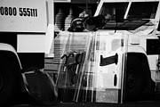 Violent Prints - PSNI protective riot gear at landrovers on crumlin road at ardoyne shops belfast 12th July Print by Joe Fox