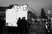 Unrest Framed Prints - PSNI riot officers behind water canon during rioting on crumlin road at ardoyne Framed Print by Joe Fox