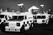 County Police Posters - PSNI surveillance landrovers with cameras on crumlin road at ardoyne shops belfast 12th July Poster by Joe Fox