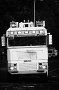 Unrest Framed Prints - PSNI water cannon on crumlin road at ardoyne shops belfast 12th July Framed Print by Joe Fox
