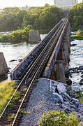 Railroad Spikes Art - Railroad tracks over a raging river by James Drake
