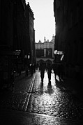 Old Krakow Framed Prints - Rain On Cobbled Streets In The Old Town Of Krakow Framed Print by Joe Fox