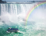Waterfalls Photos - Rainbow and tourist boat at Niagara Falls by Elena Elisseeva