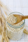 Oatmeal Posters - Raw Oats in Wooden Spoon  Poster by Tom Baker