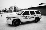 Sask Prints - rcmp royal canadian mounted police 4x4 patrol vehicle outside station in the small town of Kamsack S Print by Joe Fox
