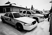 Sask Prints - rcmp royal canadian mounted police vehicles outside station in the small town of Kamsack Saskatchewa Print by Joe Fox