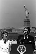 Ronald Reagan Photo Prints - Reagan Speaking Before The Statue Of Liberty Print by War Is Hell Store