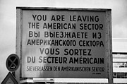 Berlin Germany Photo Prints - reconstruction of the you are leaving the american sector sign at checkpoint charlie Berlin Germany Print by Joe Fox