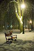 City Snow Prints - Red bench in the park Print by Jaroslaw Grudzinski
