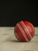 Cricket Prints - Red Cricket Ball Print by Edward Fielding