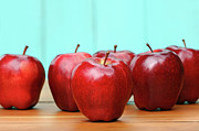 Red Delicious Apples On Old School Desk Print by Sandra Cunningham