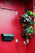 Quebec Places Prints - Red Door in Montreal Print by John Rizzuto