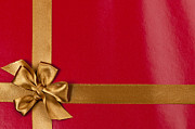Packages Prints - Red gift background with gold ribbon Print by Elena Elisseeva