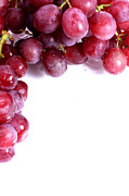 Simon Bratt Photography Acrylic Prints - Red grapes with white copy space Acrylic Print by Simon Bratt Photography