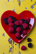 Red Fruits Framed Prints - Red heart dish and raspberries Framed Print by Garry Gay