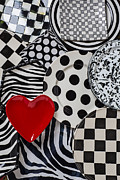 Dishware Posters - Red heart plate on black and white plates Poster by Garry Gay