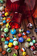 Round Photo Prints - Red jar with marbles Print by Garry Gay