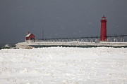 Grand Haven Prints - Red Lighthouses - Winter - Stormy Weather Print by John Stephens